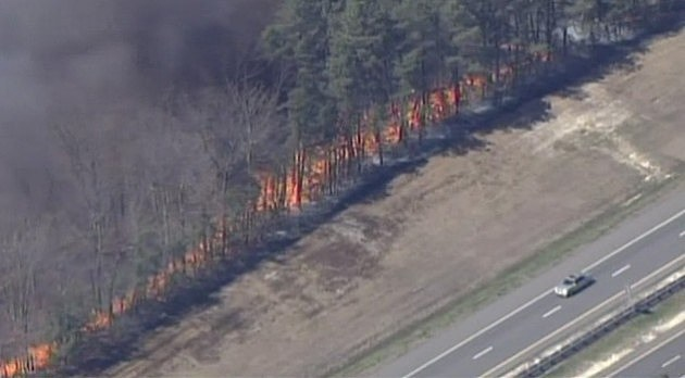 Forest fire burns along the Atlantic City Expressway