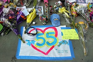 A memorial for NFL Legend Junior Seau builds as fans show their respect at the entrance way of Seau's Restaurant in San Diego
