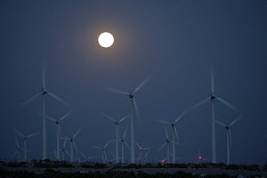 A perigee moon, or supermoon, rises behind wind turbines on May 5, 2012 near Palm Springs, California.