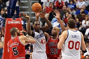Elton Brand #42 of the Philadelphia 76ers dishes off a pass to teammate Spencer Hawes #00 while being pressure by Carlos Boozer #5 and Taj Gibson #22 of the Chicago Bulls