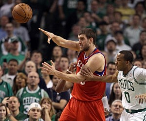 Spencer Hawes #00 of the Philadelphia 76ers passes the ball