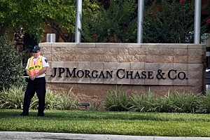 A security officer stands guard at the building where a JP Morgan Chase shareholders meeting was taking place  in Tampa, Florida