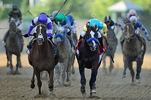 I'll Have Another ridden by Mario Gutierrez (L) beats Bodemeister ridden by Mike E. Smith at the finish line to win the 137th running of the Preakness Stakes