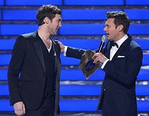 """Winner Phillip Phillips (L) and host Ryan Seacrest speak onstage during Fox's """"American Idol 2012"""" results show"""