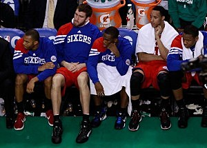 Members of the Philadelphia 76ers sit and watch on the bench in the final seconds of the game against the Boston Celtics during Game Seven