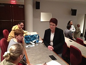 Assistant jersey Labor Commissioner Mary Ellen Clark talk with job-seekers at Mercer Community College