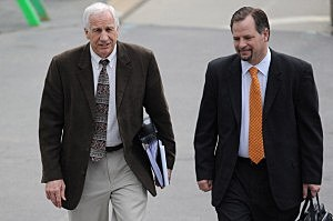 Jerry Sandusky (L) and attorney Karl Rominger (R)