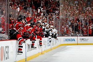 he New Jersey Devils bench starts to celebrate at the end of the game after defeating the Los Angeles Kings in game 6 in Newark.