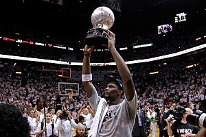 Chris Bosh #1 of the Miami Heat celebrates after the Heat defeat the Boston Celtics 101-88 and advance to the NBA Finals