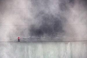 Aerialist Nik Wallenda tighropes over the Niagara Falls