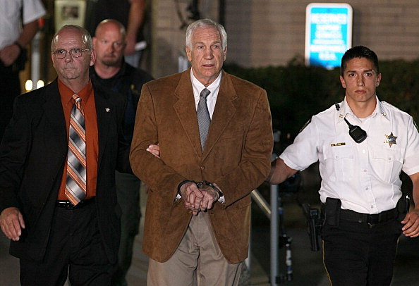 Former Penn State assistant football coach Jerry Sandusky, leaves court in handcuffs