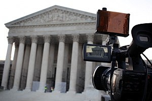 A TV camera is set up in front of the U.S. Supreme Court