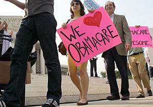 People march in support of the Obama administration's health care act