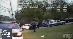 Screen shot of video showing James Bayliss being punched by State Police during a traffic stop
