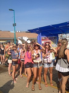 Fans wait in the heat on the Wildwood boardwalk to see Kenny Chesney