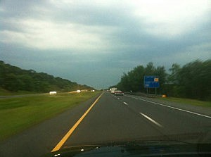 Thunderstorms loom in the western sky over Interstate 195