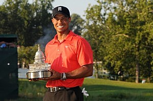 Tiger Woods poses with the winner's trophy after winning the AT&T National