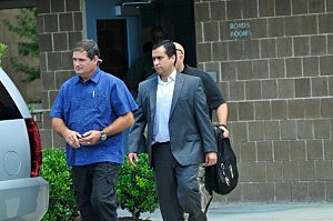 George Zimmerman (C) leaves Seminole County Jail after posting a million dollar bond