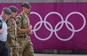 Military personnel walk from the Olympic Park in London, England