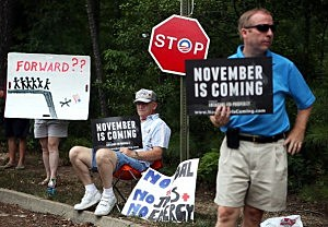 Anti-Obama residents near a campaign stop by the President in Glen Allen, Virginia