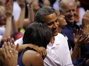 President Barack Obama hugs first lady Michelle Obama as they appear on the 'Kiss Cam'