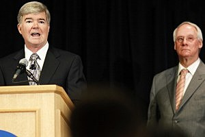 NCAA president Mark Emmert speaks as Ed Ray, chairman of the NCAA's executive committee and Oregon State president looks on,