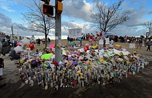 Thousands of people continue to visit the makeshift memorial for the 12 movie theater shooting victims built across the street from the Century 16 theater