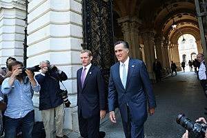 Mitt Romney (R),  arrives in Downing Street to meet with British Prime Minister David Cameron