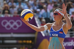 Katrin Holtwick of Germany serves during the Women's Beach Volleyball match between Germany and Czech Republic