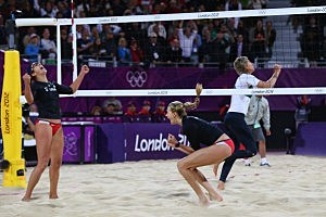 Kerri Walsh Jennings (R) and Misty May-Treanor (L) of the United States celebrate after winning against Australia during the Women's Beach Volleyball Preliminary Round on Day 1 of the London 2012 Olympic Games