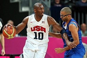 Kobe Bryant #10 of United States drives against Tony Parker #9 of France