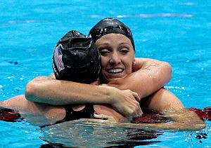 Dana Vollmer (R) of the United States celebrates with teammate Claire Donahue (L) after winning the gold medal and setting a new world record time of 55.98 seconds in the Women's 100m Butterfly final on Day 2 of the London 2012 Olympic Games