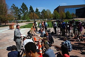 Robert McCallum, a spokesman for the courts, briefs the media in front of the Arapahoe County Courthouse where the arraignment hearing for Colorado shooting suspect
