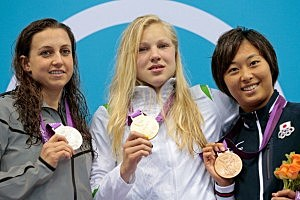 (L-R) Silver medalist Rebecca Soni of the United State, gold medalist Ruta Meilutyte of Lithuania and bronze medalist Satomi Suzuki of Japan celebrate with their medals during the medal ceremony for the Women's 100m Breaststroke on Day 3 of the London 2012 Olympic Games