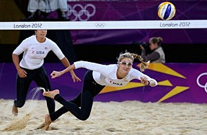 Kerri Walsh Jennings of the United States dives for a shot during the Women's Beach Volleyball Preliminary match between United States and Czech Republic on Day 3 of the London 2012 Olympic Games