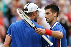 Novak Djokovic (R) of Serbia shakes hands with Andy Roddick (L) of the United States after defeating him in the second round of Men's Singles Tennis on Day 4 of the London 2012 Olympic Games