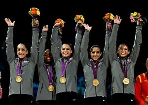 Jordyn Wieber, Gabrielle Douglas, Mc Kayla Maroney, Alexandra Raisman and Kyla Ross of the United States celebrate on the podium after winning the gold medal in the Artistic Gymnastics Women's Team final