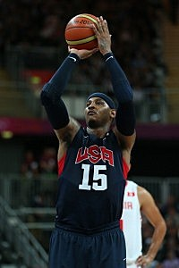 Carmelo Anthony #15 of United States shoots a free throw against Tunisia during the Men's Basketball Preliminary Round match