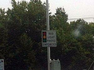 Red light camera sign in Brick