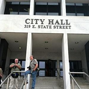 Reporters outside Trenton City Hall