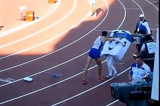 Mahiedine Mekhissi-Benabbad pushes mascot.