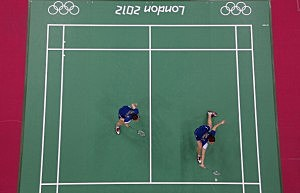 Jung Kyung Eun and Kim Ha Na of Republic of Korea compete against Valeria Sorokina and Nina Vislova of Russia during their Women's Doubles Badminton match