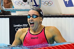 Rebecca Soni of the United States reacts after she finished first and set a new world record in the second semifinal heat of the Women's 200m Breaststroke