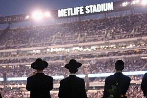 Orthodox Jews gather to celebrate the completion of study of the entire Talmud religious text at MetLife Stadium