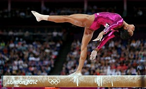 Gabrielle Douglas of the United States competes on the balance beam in the Artistic Gymnastics Women's Individual All-Around final