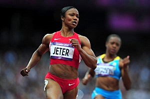 Carmelita Jeter of the United States competes in the Women's 100m Round 1 Heats