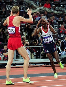 Mohamed Farah of Great Britain celebrates winning gold with silver medalist Galen Rupp of the United States