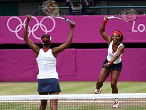 Serena Williams (R) and Venus Williams (L) of the United States celebrate after defeating Andrea Hlavackova and Lucie Hradecka of Czech Republic in the Women's Doubles Tennis gold medal match