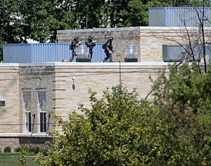 Police SWAT officers surround the Sikh Temple of Wisconsin