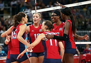 Logan Tom #15,Jordan Larson #10,Courtney Thompson #17,Foluke Akinradewo #16 and Destinee Hooker #19 of United States celebrate the win over Turkey during Women's Volleyball